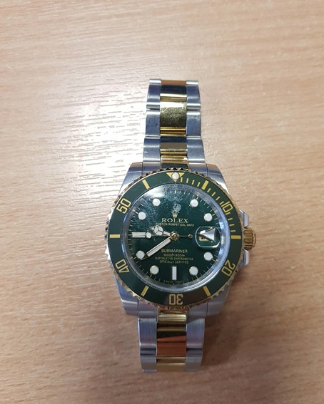 Rolex multi-tone watch with green dial