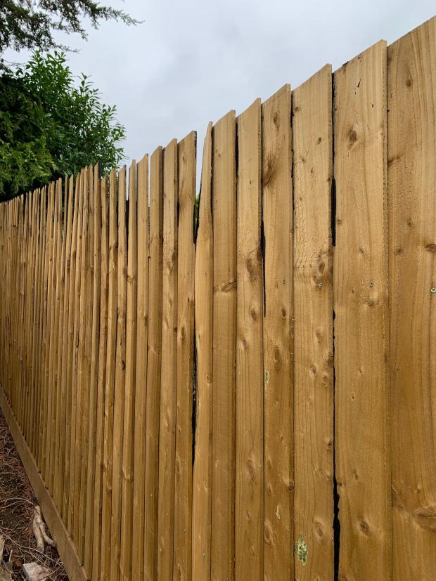 South Wales Argus: The fence which had been installed in Lisa Potter's garden warped within a few weeks. Picture: Lisa Potter.