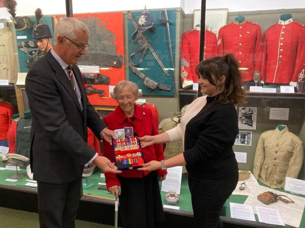 South Wales Argus: Lord Lieutenant for Gwent Brigadier Robert Aitken and Joan Reynolds MBE presenting Royal Regiment of Wales Museum curator Amanda Rosemarme with Lyndon Sheedy medals