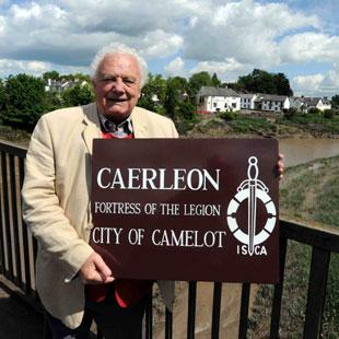 CAERLEON STALWART: Dr Russell Rhys with a sign he proposed for his historic home town