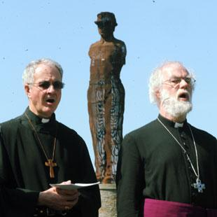 The Bishop of Monmouth Dominic Walker, left and the Archbishop of Canterbury Dr Rowan Williams with the memorial statue behind