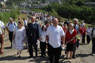 CROWDS walk up the hill to the Six Bells memorial