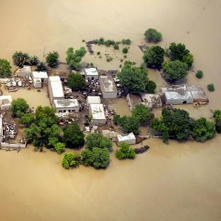 Houses and narrow surrounding are are left amid flooded waters in Kot Addu, Pakistan