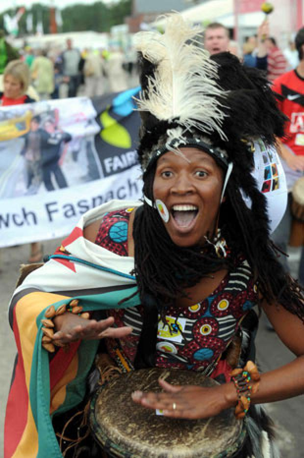 South Wales Argus: DRUMMING UP SUPPORT: Martha Musonza Holman leading the march