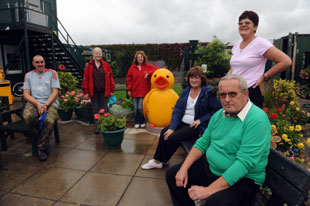 BLOOMING: Bettws in Bloom trustees at their gardens which have won an It's Your Neighbourhood award in Britain in Bloom