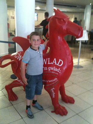 My son Jack with the touring dragon Evan James in London..He only has 1 dragon to mark off on his map now...