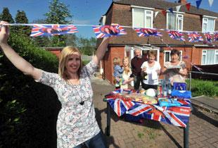 CELEBRATION: Claire Young her family and her neighbours prepare for a royal wedding street party on church crescent in Bassaleg