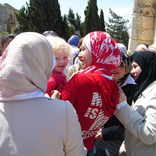 SYRIAN SNAP-HAPPY: My daughter Carys surrounded by Syrian schoolgirls