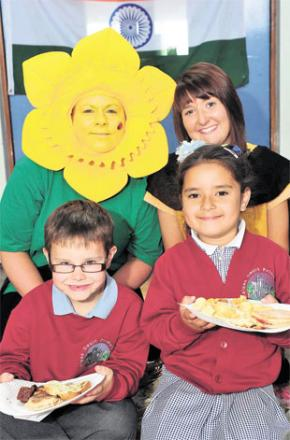 NEW TASTES: At the Welsh- Indian food festival at Malpas Court Primary School, Newport, are, from left, teachers Ceri Rawlings and Ashleigh Mansfield, with pupils Harri Morgan and Isabella Smith tucking into the food