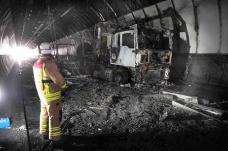 WRECKED: The remains of the lorry which caused extensive damage to the tunnel when it exploded yesterday. Pic: Malcolm Morgan