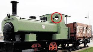 WELCOME RELEASE: The train engine in Newport city centre showing, circled, one of the portholes in which the teenager was trapped