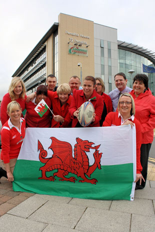 SEEING RED: Caerphilly council staff show their support for Wales