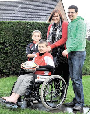 MAKING PROGRESS: Lewis Perham, nine, with brother Leo, seven, and parents Claire and Iestyn