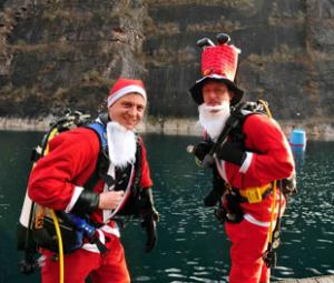 SANTAS IN THE SWIM: Ray Phillips, right, from Blaenavon, with Richard Brown, from Malpas