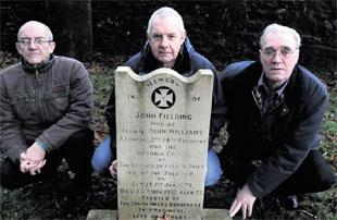 RELIEVED: Cwmbran and District Ex-Servicemen's Association members Tony Burnett, Bryn Carr and Peter Cosley at the grave of Rorke's Drift hero John Fielding at St Michael's Church, Llantarnam