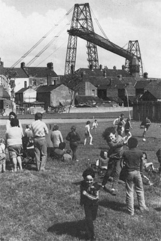 South Wales Argus: PICTORIAL MEMORIES: Children playing in the shadow of Newport's Transporter Bridge in Pill