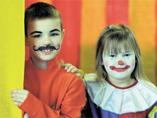 IN THE BIG TENT: Morgan Hall and Carys Hallett at Pontnewydd Primary School dressed up as part of their study of circuses