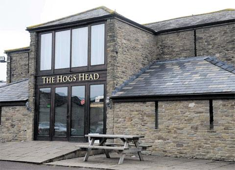 WELCOME DIVERSION: The Hogs Head, and below, Caroline Woollard tucks in to a mouthwatering dessert