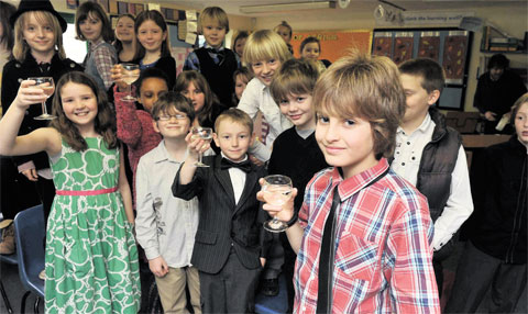CHEERS: Reuben Wallace, far right, who won the Welsh Book Council's World Book Day animation competition is congratulated by his fellow pupils at Cross Ash Primary School for his prize work