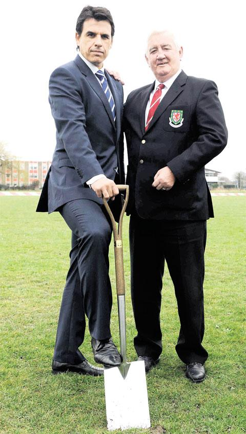 MILESTONE: Wales manager Chris Coleman and Phil Pritchard, president of the Football Association of Wales, cut the first sod to mark the building of a national football centre in Newport