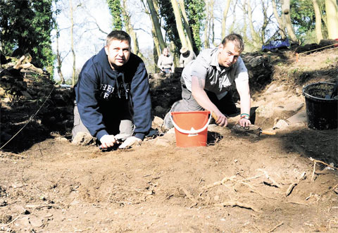 DIGGING IN: Corporal Steven Winterton, left, and Rifleman Savage are seen digging at the site in Caerwent