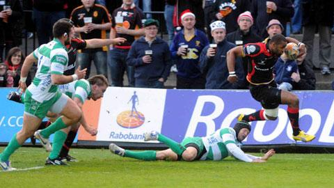 HEADING HOME: Aled Brew skips past Kris Burton in his last spell at the Dragons