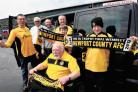 CHAUFFEUR-DRIVEN: Newport County fan Ken Fletcher, front, with, from left, Bob Herrin, chairman of Newport County Supporters; driver Roy Johnson; Mr Fletcher's son Christopher Fletcher; Jeff Challingsworth, secretary of the supporters' club; and Mr Fl