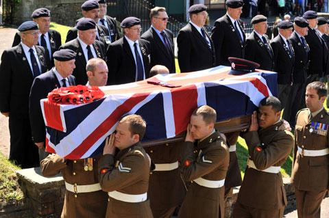 FINAL JOURNEY: Sapper Connor Ray's coffin is carried to Newport Cathedral