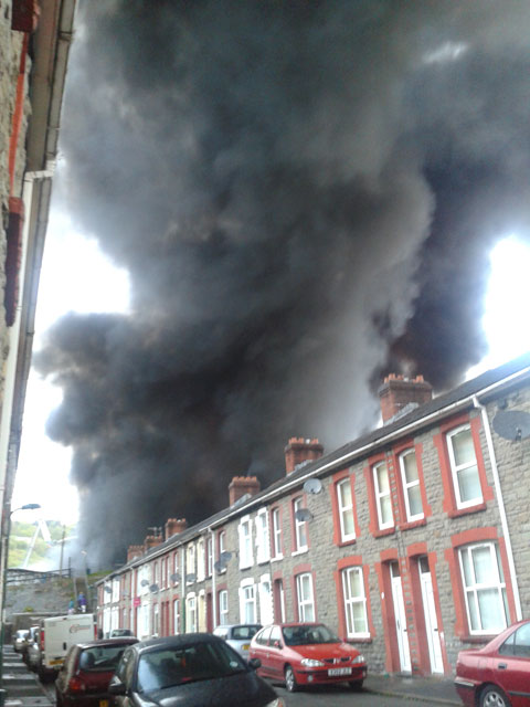 "Clair Beacham sent this picture of the massive plume of smoke billowing outside her house. She said: ""I've been awake since 1.30 this morning because of explosions""."