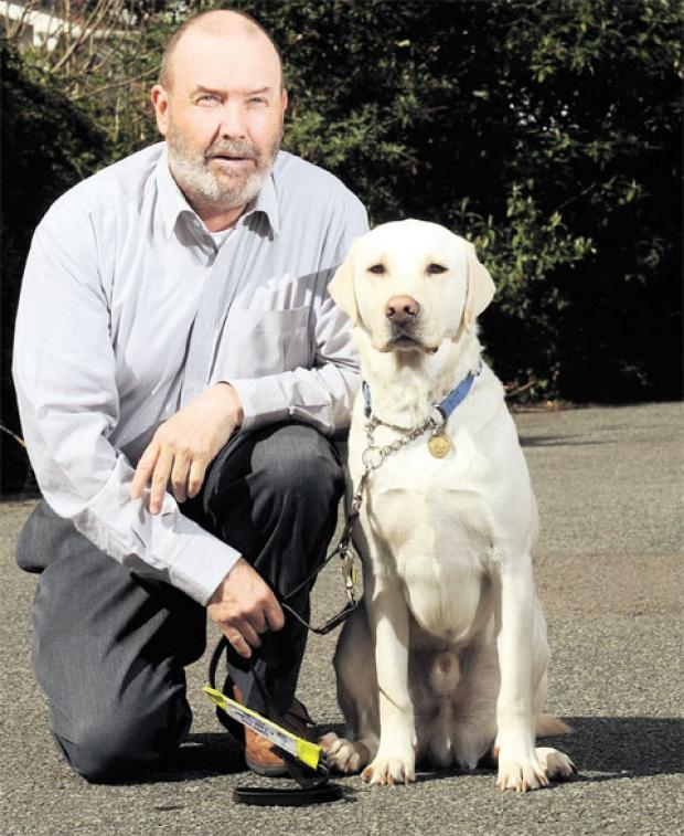 REGISTERED BLIND: Tony Harris with his guide dog