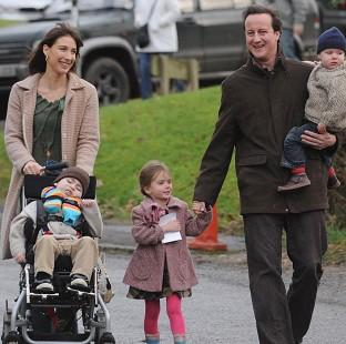 David Cameron, pictured in 2007 with wife Samantha and their children, has written of his grief at the death of his eldest son Ivan (left)
