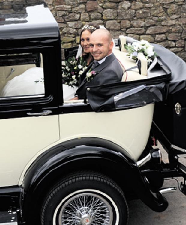 TRAVELLING IN STYLE: The newlyweds arrived at and departed from the church in a vintage car