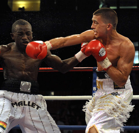 GREAT SHOT: Lee Selby hits Patrick Okine with a  devastating right in their Commonwealth Featherweight Championship showdown at the Newport Centre PICTURE: MIKE LEWIS