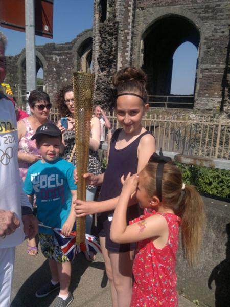 Jasmine Gibbons, 10 and Layla Gibbons, six at the Olympic torch relay. From Nathan Gibbons.