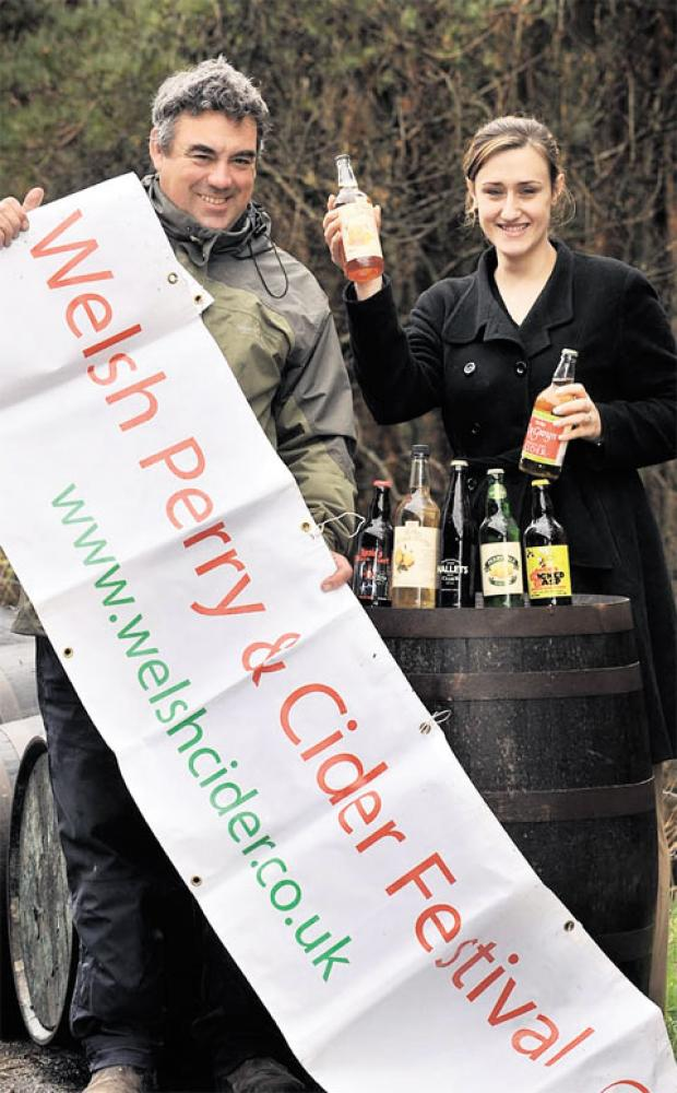 CIDER MAKERS: Andy Hallett and Rachel Matthews, of Blaengawney Cider, promote the annual Welsh Perry and Cider Festival