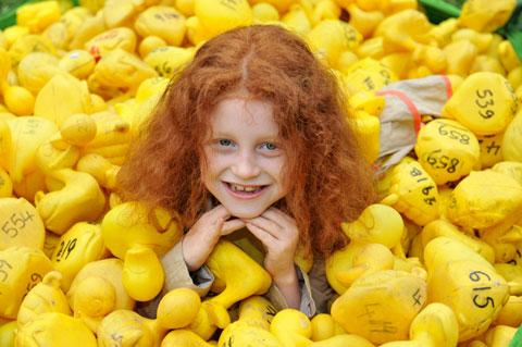 Quackers: Lilli Edwards, aged seven, helps with the launch