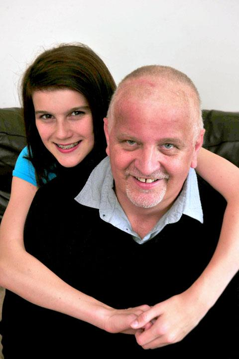 TOP DAD: Andrew Purvis with his partner Sian Levi's daughter Bethan Morgan, 12