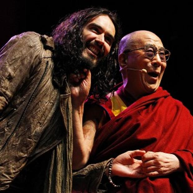 Russell Brand and the Dalai Lama on stage at the Manchester Evening News Arena