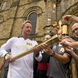 Ashes-winning cricketer Paul Collingwood brandished the Olympic Torch like a cricket bat as he started Day 30 of its tour around Britain and Ireland