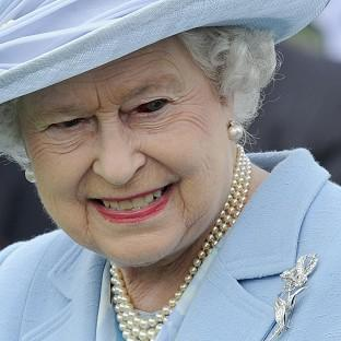 The Queen sports a bloodshot left eye at the Cartier Queen's Cup at Guards Polo Club, Windsor