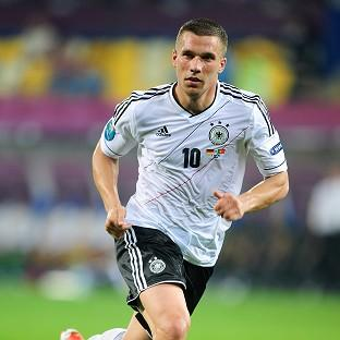 Lukas Podolski marked his 100th appearance from Germany with a goal against Denmark