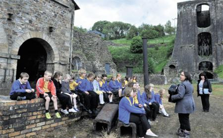 OUR HERITAGE: Children from Blaenavon Heritage School practise their singing at the Iron Works,