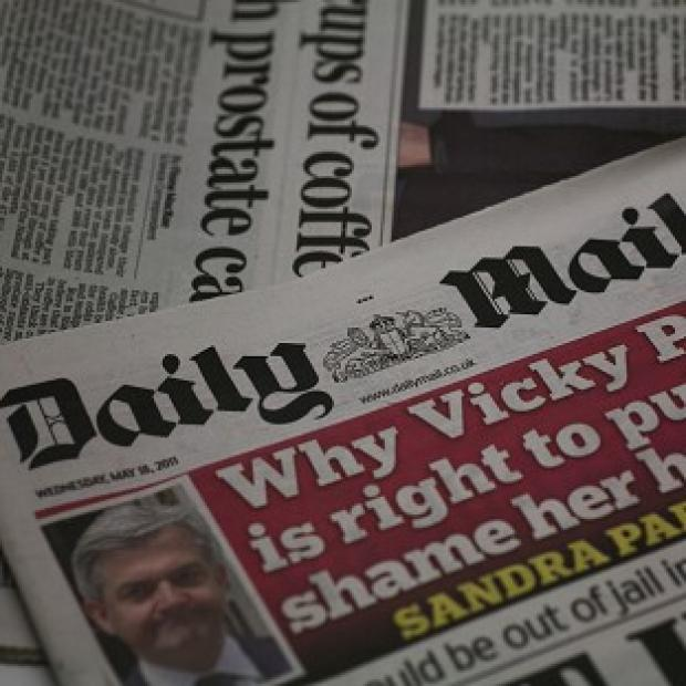 A court has awarded libel damages to a university tutor over a story in the Daily Mail