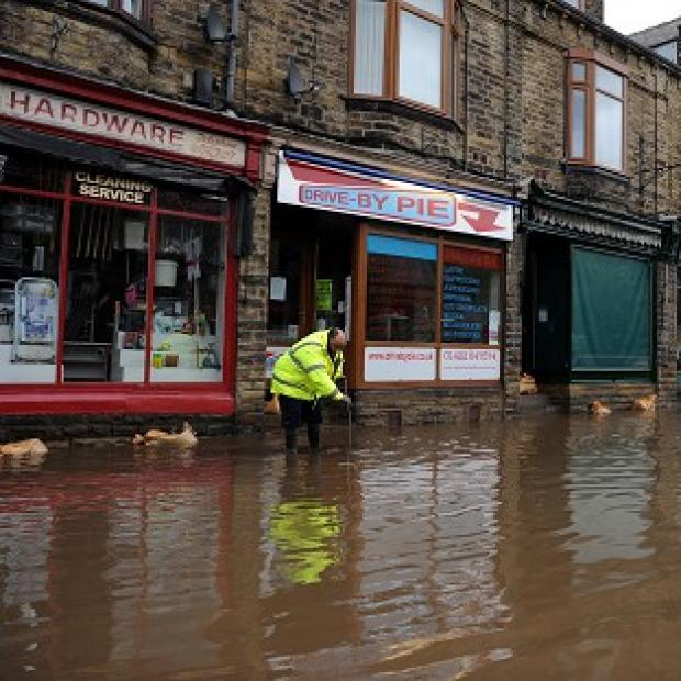 Floodwaters surrounds local shops in the centre of Mytholmroyd near Huddersfield after torrential downpours
