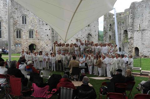 SINGING OUT OF THE RAIN: Singing Club perform under the new canopy at Chepstow Castle during the launch of the town's festival