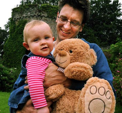 BEAR HUGS: David Lee of Llanfair Kilgeddin with nine-month-old daughter Carys join in the teddy bears picnic at Usk Castle
