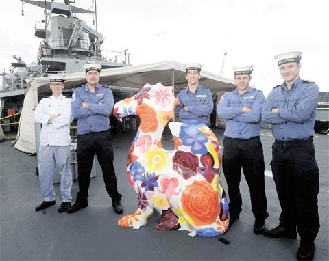 NEW SHIPMATE: Leading Chef Tame, AB Walters, AB Mosley, AB Fellows and ET Powell aboard HMS Severn with Blodeuwedd, the SuperDragon decorated by Carys Heath