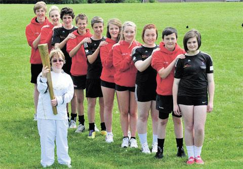 HONOUR: Pupils from Blackwood Comprehensive with torch bearer Sara Pickard, 28 from Pentyrch