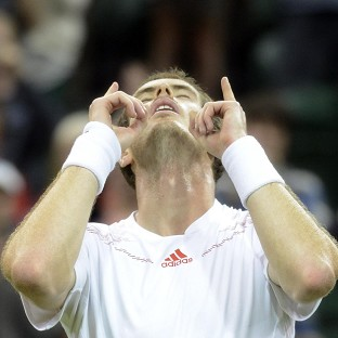 Andy Murray celebrates his hard-fought win under the Centre Court roof