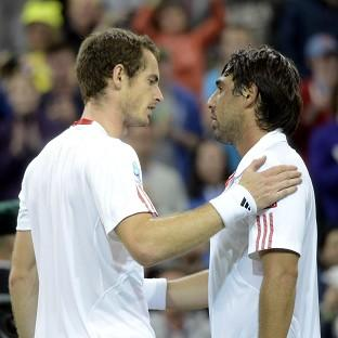 Andy Murray is congratulated on his victory by Marcos Baghdatis on day six of the 2012 Wimbledon Championships